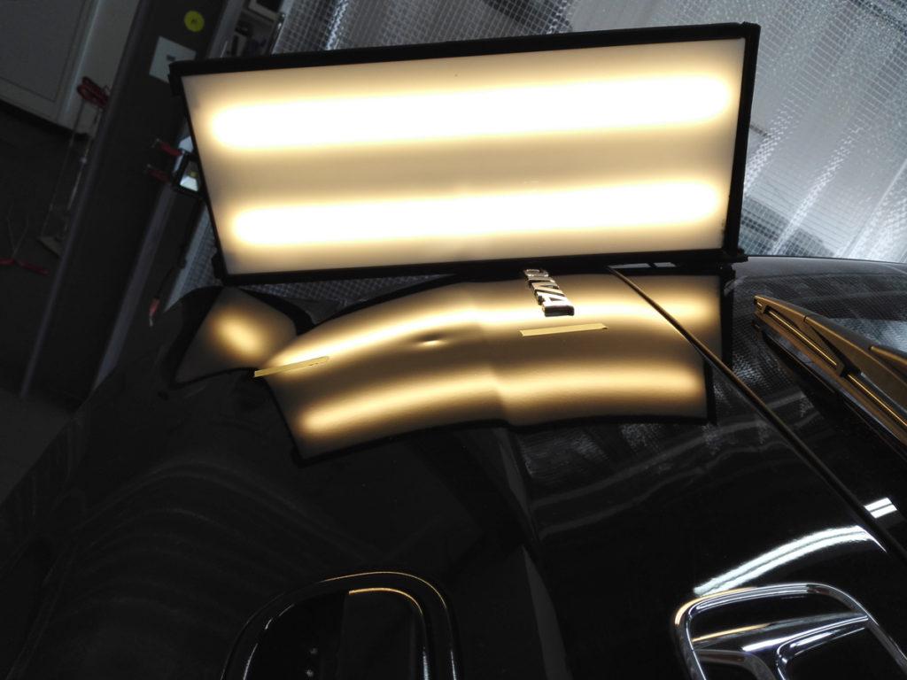 Dent on Honda Life rear gate with lighting