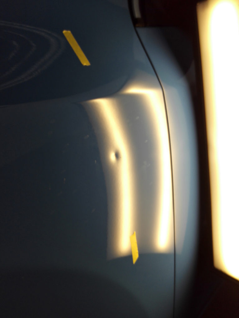 A dent on the fender of V60
