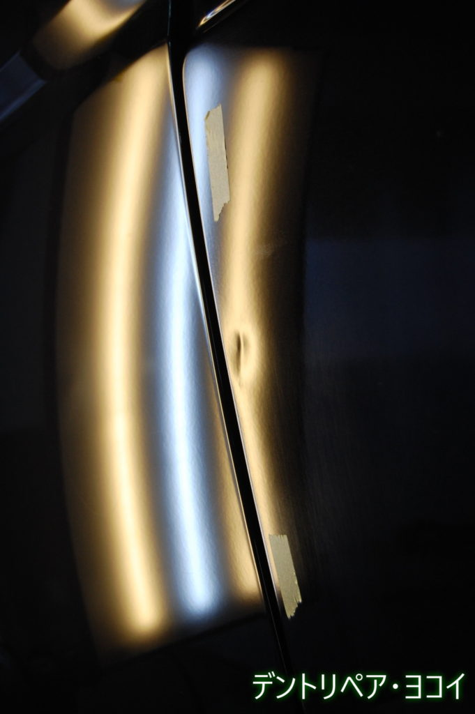 dented rear fender of TOYOTA