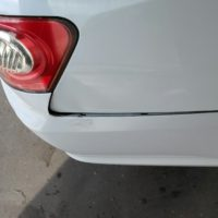 dented fender, dislocated bumper